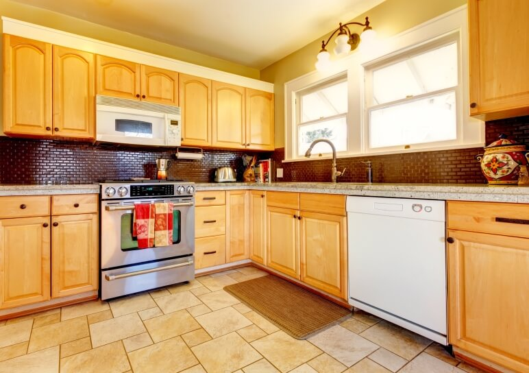 yellow kitchen with backsplash